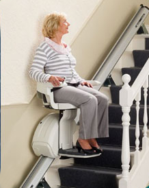 lady on stairlift looking up the stairs