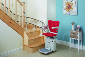 Red stairlift at bottom of stairs