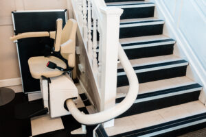 White stairlift on staircase elderly people indoor in home